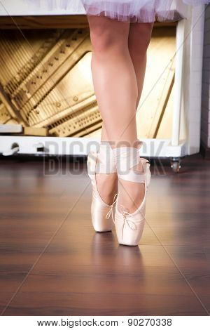 Ballerina Legs In Pointes On Dancing Hall