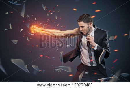 Strong businessman boxing