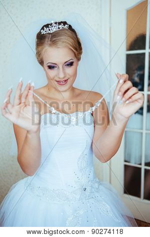 Beautiful caucasian bride getting ready for the wedding ceremony
