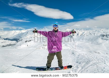 Joyful Snowboarder With Hands Up