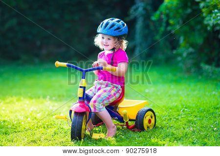 Little Girl On A Bike