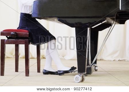 girl plays the piano during a concert