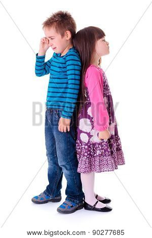 Little Aggrieved Boy Standing Near Girlfriend