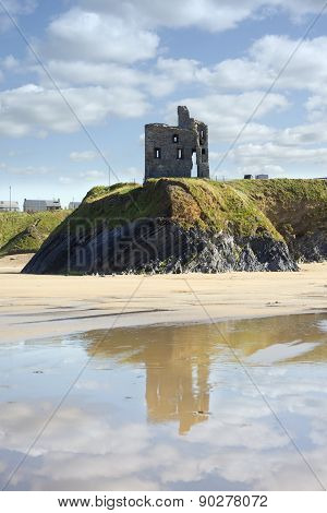 Castle And Beach With Beautiful Reflection Of The Clouds