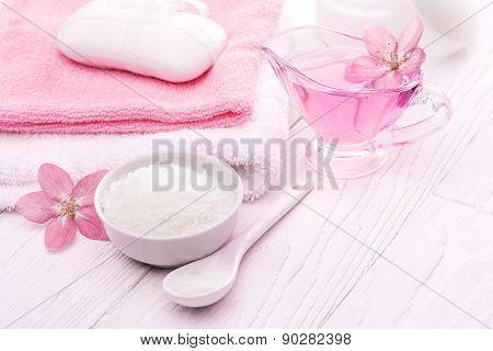 sea salt and essential oils, pink flower. spa