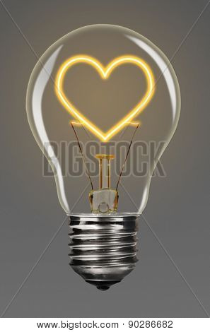 bulb with glowing heart inside of it, creativity concept