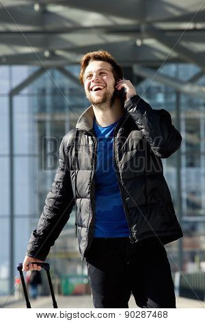 Happy Attractive Man Walking And Talking On Mobile Phone