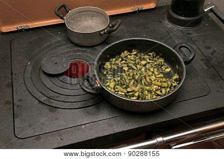 Green Zucchini With Pot Over The Stove In The Mountains