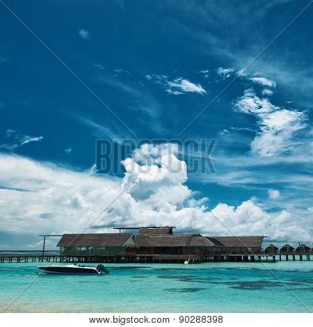 Beautiful island beach with motor boat at Maldives