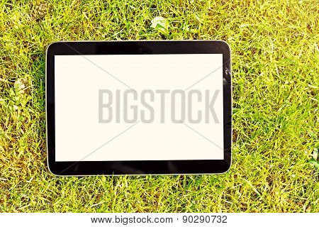 Blank Digital Tablet Lying On Green Grass