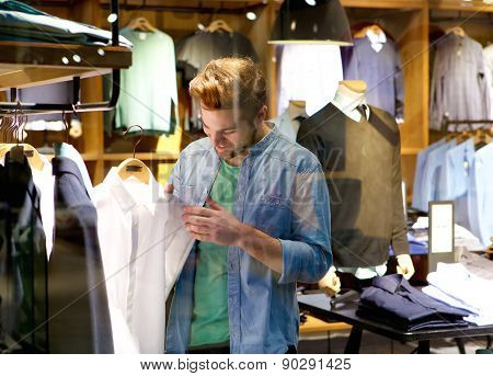 Happy Man Shopping For Clothes At Clothing Store