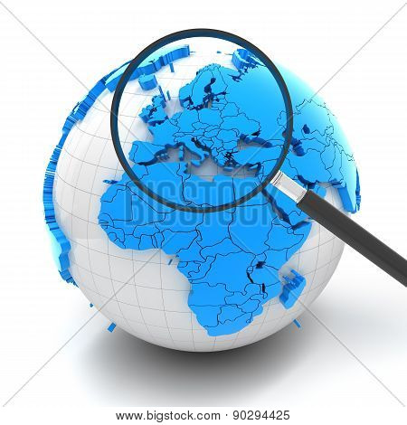 Globe with magnifying glass over Europe