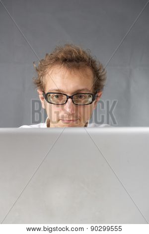 Cute young man with laptop.