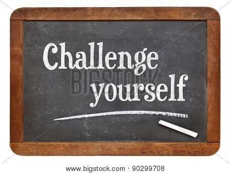 Challenge yourself - motivational text  on a vintage slate blackboard