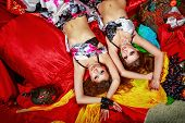 image of harem  - Two attractive sexy oriental beauty lie invitingly on pillows - JPG
