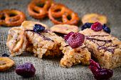 stock photo of pretzels  - Grazing Snack Food On A Rustic Background consisting of sun dried cranberries - JPG