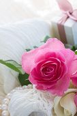 image of mother-of-pearl  - fresh pink  rose flower with lace and pearls - JPG