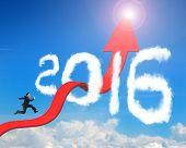 foto of bend  - Businessman running on red arrow upward bending trend line breaking through 2016 shape clouds and blue sky sunlight background - JPG