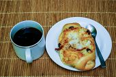 foto of fill  - Bread filled with sweeten coconut with black coffee on bamboo plate - JPG