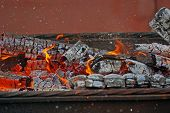 stock photo of firewood  - burning firewood in mongale for barbecue outdoors - JPG