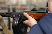 image of gun shot  - A man pointing a retro automatic machine gun outdoor horizontal shot  - JPG