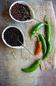 image of peppercorns  - closeup green chilli peppers and different types of peppercorns - JPG