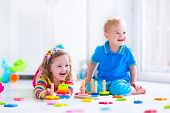 picture of kindergarten  - Kids playing with wooden toys - JPG