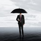 pic of crisis  - Business man standing on the water - JPG