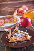 stock photo of pie-in-face  - apple pie on plate and on a table - JPG