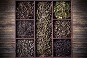 pic of crate  - Assortment of dry tea leaves in wooden crate - JPG