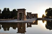 stock photo of isis  - Egyptian Temple reflected in the water in Madrid Spain - JPG