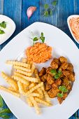 pic of fried chicken  - Fried chicken pieces with french fries and sauces - JPG