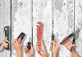 foto of hand tools  - Set of peoples hands holding different tools on white board texture background - JPG