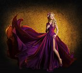 foto of waving  - Model in Purple Dress Woman Posing in Flying Silk Cloth Waving on Wind Beauty Fashion Portrait - JPG