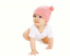 image of crawl  - Portrait of sweet baby crawls in the pink knitted hat and looking up - JPG