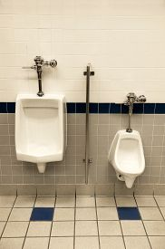 stock photo of urinate  - Shot of public urinals in a building - JPG