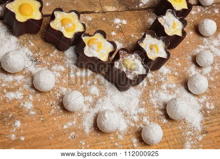Candy In Heart Shape On Wooden Background