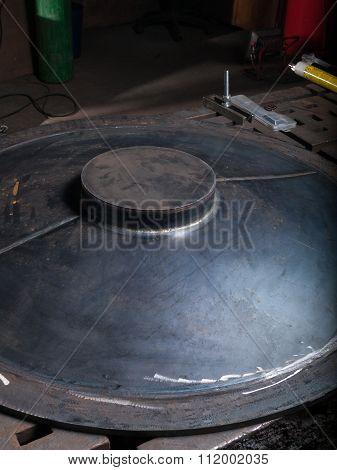 Metallic blue metal plate in a metal work factory