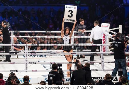 Boxing Ring Girls Holding A Board With Round Number