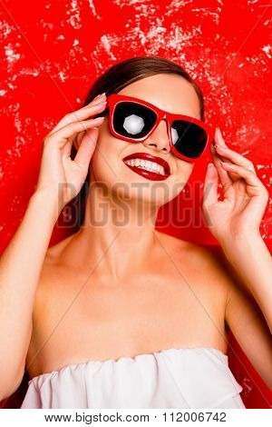 Glamorous Cheerful Girl With Red Lips With Spectacles Against The Red Background