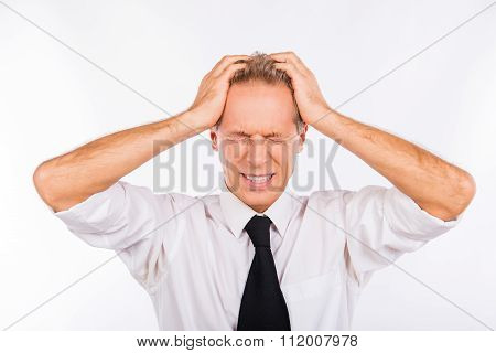 Mature Office Worker Suffering From Headache