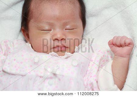 Sleeping Japanese new born baby girl (0 year old)