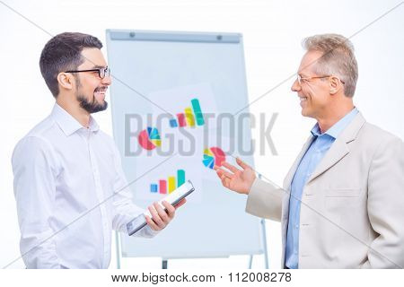 Business colleagues cooperating with each other.