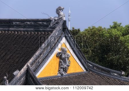 Buddhist Statues On Building Exterior