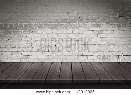 Wood table with White brick wall background