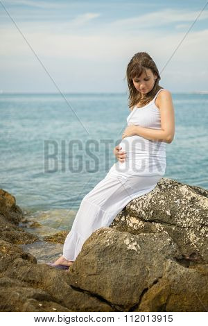 Young Pretty Woman With White Dres Relaxing At The Beach