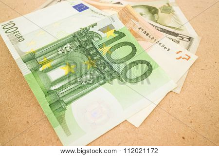 International Currencies Bank Note On Wooden Table