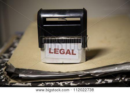 Legal Stamp On A Big Folder Of Paperwork