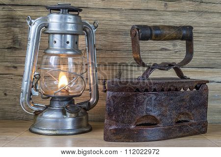 Aging Oil Lamp And Flatiron