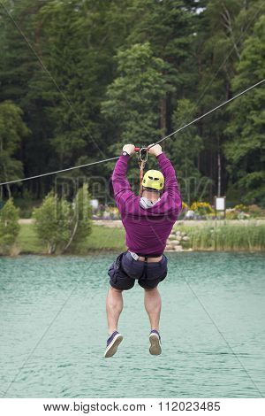 Muscled Man On Zip Line